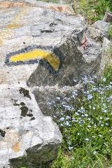 Hiking sign on a rock near Zermatt