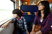 Mom and son in train