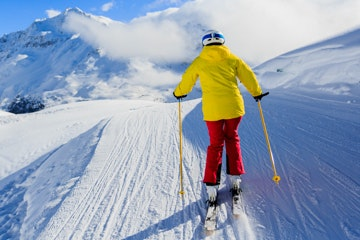 Cross-country skier in snowy Swiss mountains