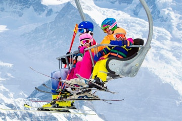 Jungfrau with family in ski lift