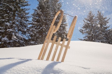 Sled on a snowy hill