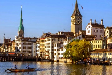 Varied Zurich walking tour on shore, on water and in the air