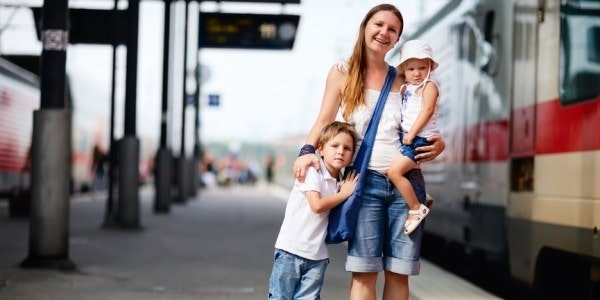 Mom and children at rail station
